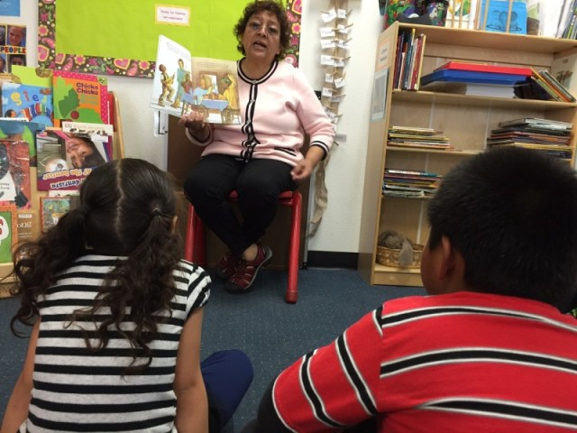 Amapola Beenn reads to her students in Spanish. Later another teacher will read to the group in English.