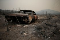 A car burned during the early hours of the Rocky Fire is pictured Thursday.