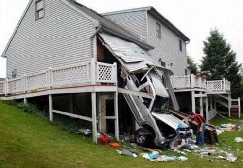Car Crashes Through Garage