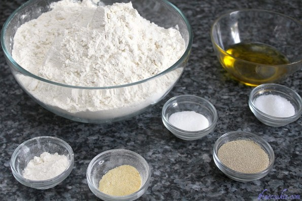 Bread flour, all purpose flour, olive oil, sugar, salt, all purpose flour, corn meal