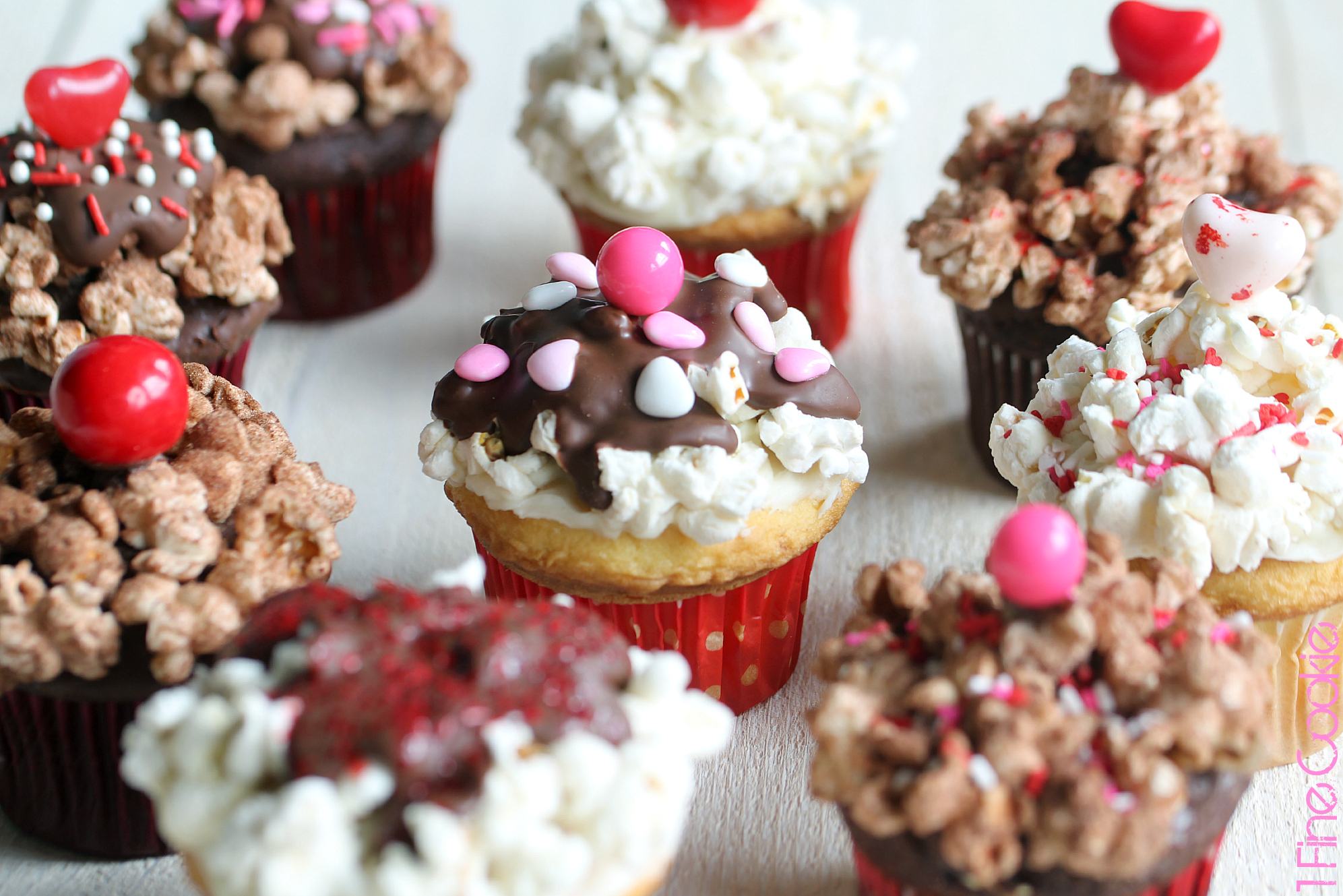Valentine's Popcorn Sundae Cupcakes by 1 Fine Cookie, valentine's, day, recipe, cupcake, chocolate, vanilla, yellow, cake, pink, red, white, sprinkles, popcorn, seasoned, salty, savory, sweet, sprinkles, sundae, party, idea, cherry, heart, brown, white, ice, cream, dessert, sweets, fudge,