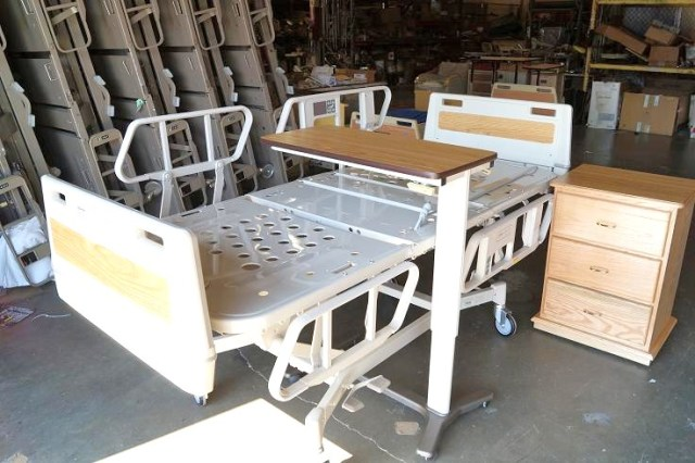 Hospital bed Hill Rom Advance Series with side bed table and over bed table