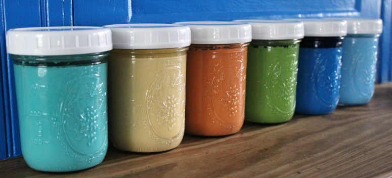 Using canning jars to store touch-up paints.