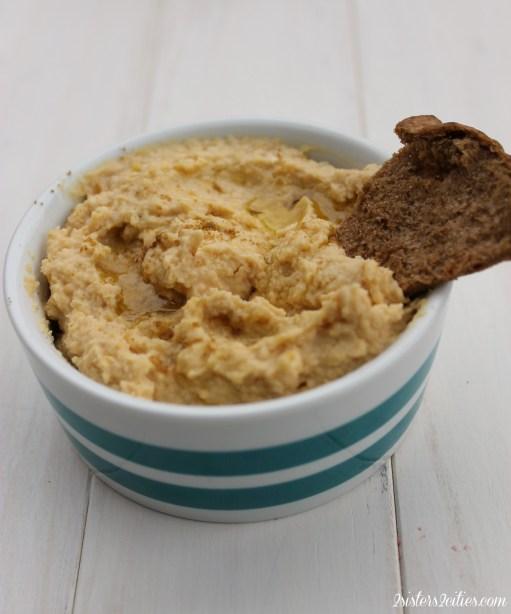 Pita Chip Dipped in Hummus