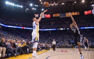 January 25, 2016; Oakland, CA, USA; Golden State Warriors guard Stephen Curry (30, left) shoots the basketball against San Antonio Spurs forward David West (30, right) during the first quarter at Oracle Arena. Mandatory Credit: Kyle Terada-USA TODAY Sports
