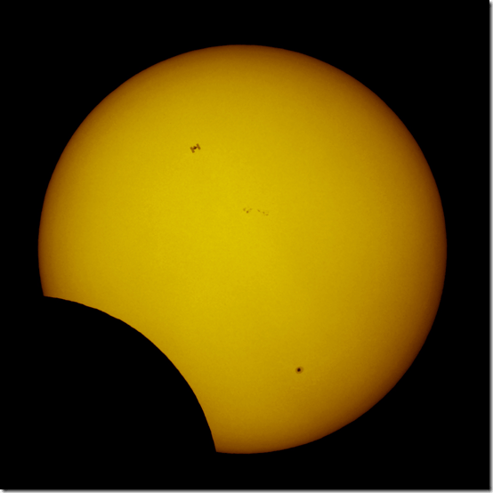 Photo of International Space Station as it Passes Across the Sun During Partial Solar Eclipse | Thierry Legault