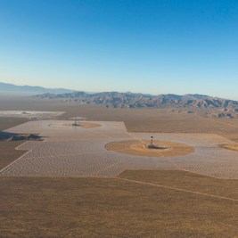 IVANPAH, CALIFORNIA, APRIL 05 2013: An aerial view of the Ivanpah Solar Power Facility at sunrise, with Tower 3, foregroud, 2 and 1. Heliostats installation is nearly completed. Located in the Mojave Desert 40 miles southwest of Las Vegas, The Ivanpah Solar Power Facility is a solar thermal power project, currently under construction, with a planned capacity of 392 megawatts, enough to power approximately 140,000 houses. It will deploy 170,000 heliostat mirrors spread over 4,000 hectares, focusing solar energy on boilers located atop three solar power towers, generating steam to drive specially adapted steam turbines The project, developed by Bechtel, will cost $2.2 billion and be the largest solar farm in the world (photo Gilles Mingasson/Getty Images for Bechtel).