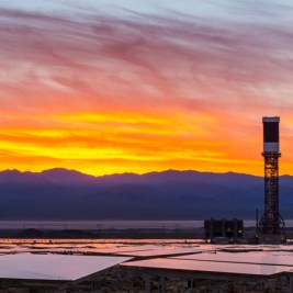 IVANPAH, CALIFORNIA, APRIL 04 2013: Tower 2 and its heliostats at sunrise at the Ivanpah Solar Power Facility. Located in the Mojave Desert 40 miles southwest of Las Vegas, The Ivanpah Solar Power Facility is a solar thermal power project, currently under construction, with a planned capacity of 392 megawatts, enough to power approximately 140,000 houses. It will deploy 170,000 heliostat mirrors spread over 4,000 hectares, focusing solar energy on boilers located atop three solar power towers, generating steam to drive specially adapted steam turbines The project, developed by Bechtel, will cost $2.2 billion and be the largest solar farm in the world (photo Gilles Mingasson/Getty Images for Bechtel).