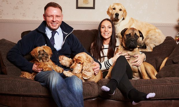 Richard Remde, Laura Jacques and dogs. Photograph: Christopher Thomond for the Guardian