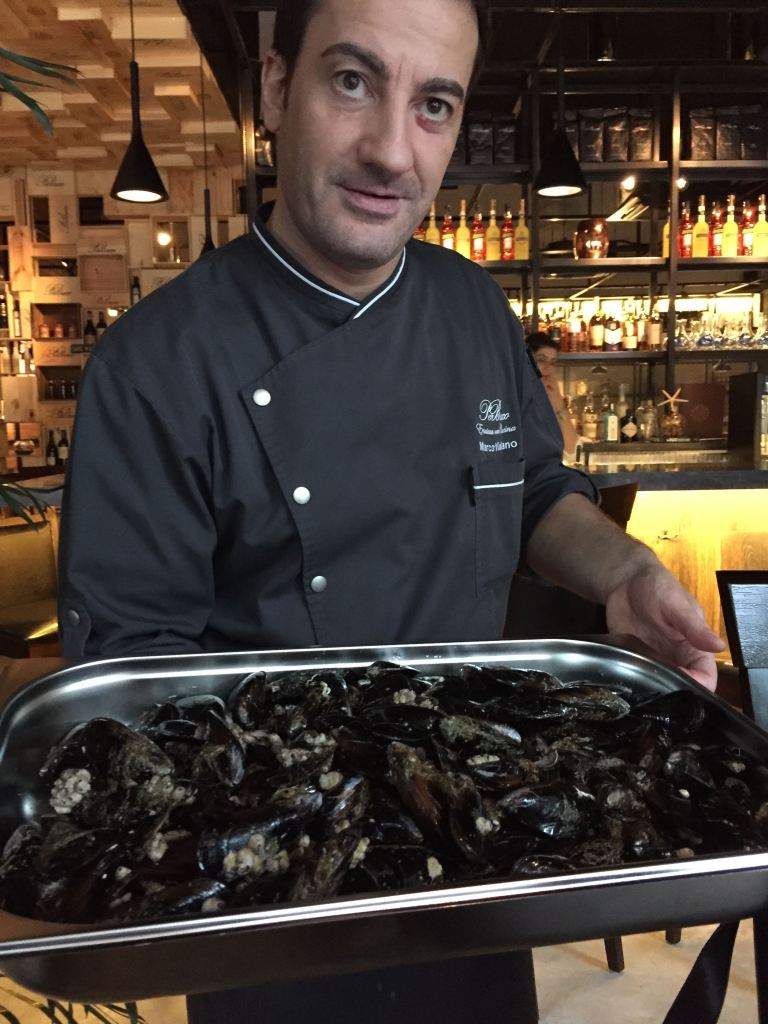 Marco showing me mussels that were just flown in from Italy