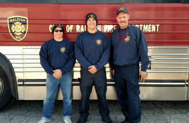 Captain Rigda, Firefighter Green, & Firefighter Martinez preparing to depart with the task force