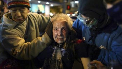 AP photo of 84 yo. Dorli Rainey after police pepper-sprayed her in the face Tuesday night at Occupy Seattle.