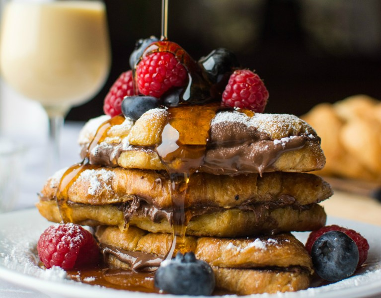 Eggnog-infused french toast overflowing with rich, chocolatey nutella!
