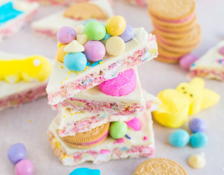 Marshmallowy Peeps rice krispies sandwiched between rich white chocolate and adorned with M&Ms, sprinkles, and Peeps Oreos!