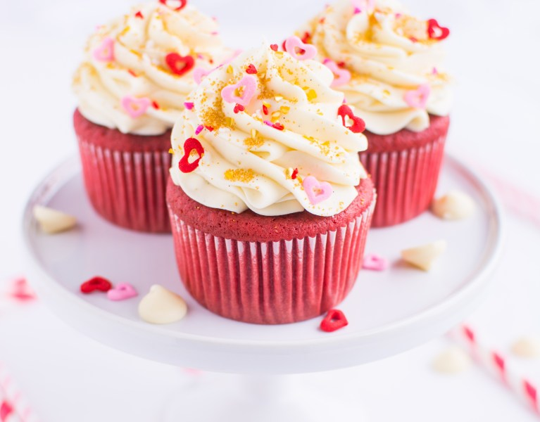Moist and oh-so-fluffy red velvet cupcakes topped with a whipped, lusciously tangy white chocolate cream cheese frosting!