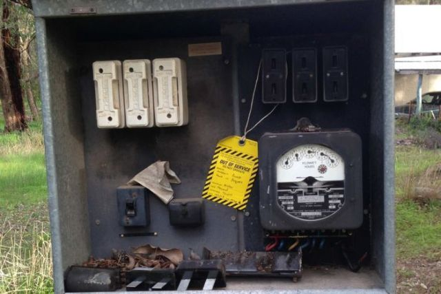 A 2013 photo of the meter box on the power pole in question, with an out of order sign on it.