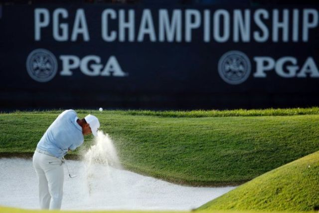 Brooks Koepka hits out of a bunker.