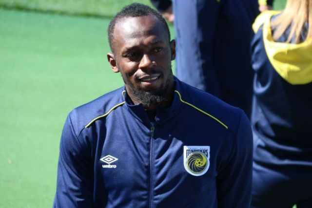 Usain Bolt smiles at his first training session with Central Coast Mariners in Gosford.