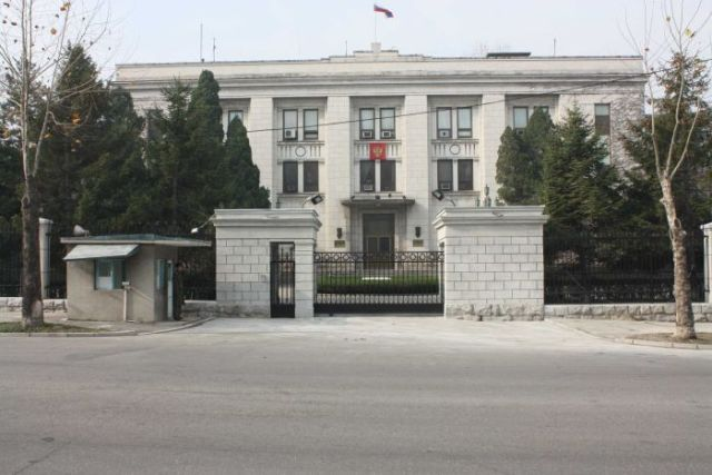 A gated Russian embassy in Pyongyang guarded by security