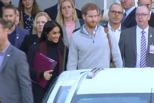 Prince Harry and Meghan at an airport