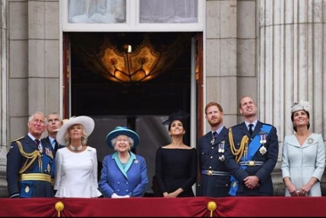 The Royal family stand on the balcony at Buckingham Palace.