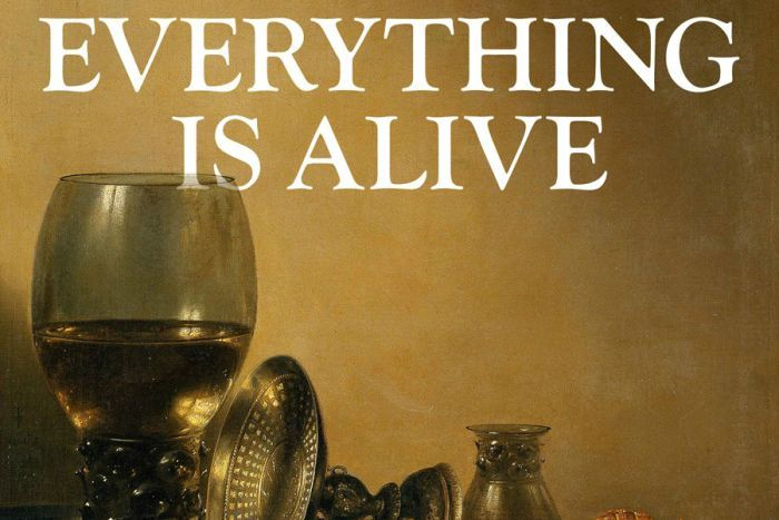 A wine glass, two plates with food on them, and two decorative objects, with 'everything is alive' written above them.