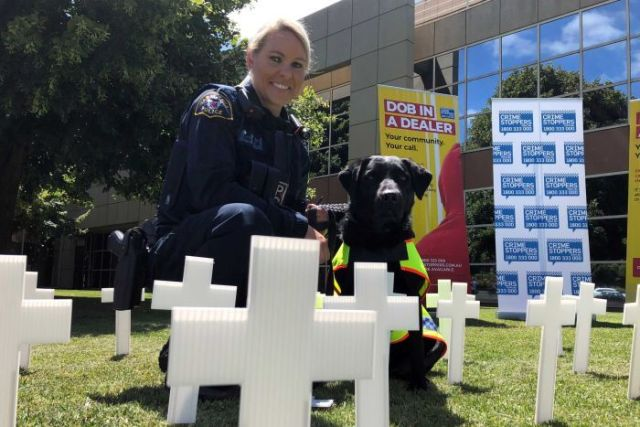 Senior Constable Anne-Marie Bennett, with sniffer dog Aggie.