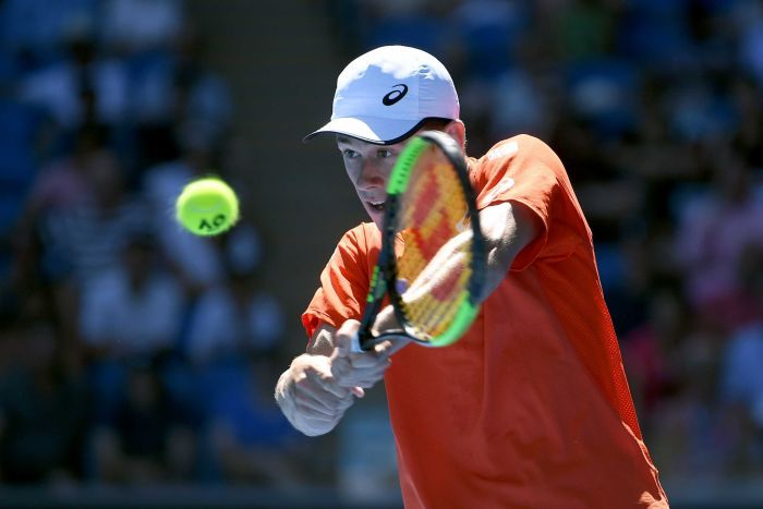 Alex De Minaur hits a double-handed backhand during his Australian Open match against Pedro Sousa