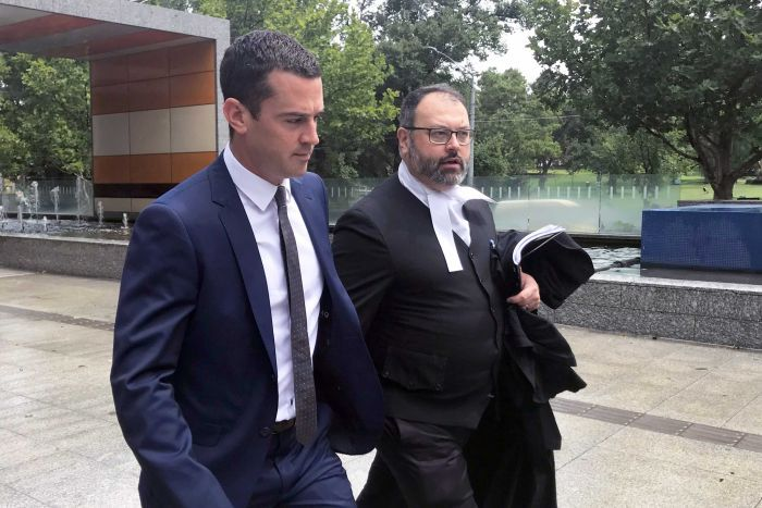 David De Garis leaves court (left) with his lawyer.