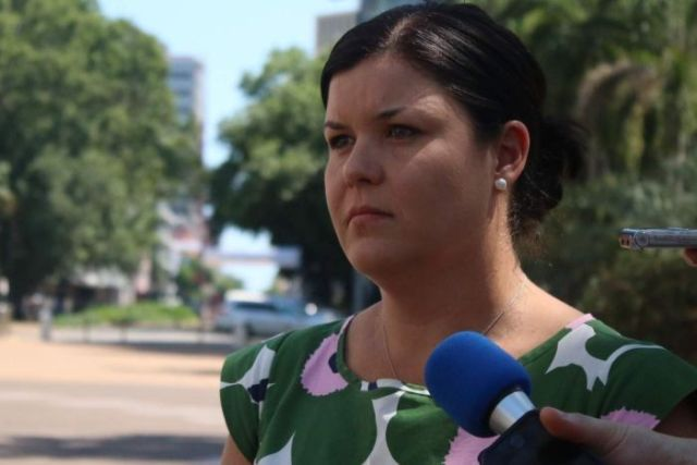 Natasha Fyles looking stern outside parliament house in darwin.