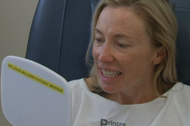 Susie Robinson looks at her smile for the first time after the operation