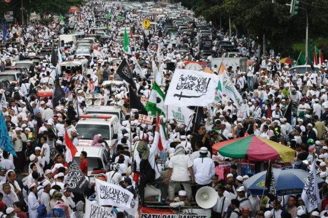 "Muslim protesters march during a protest against Jakarta's Christian Governor Basuki ""Ahok"" Tjahaja Purnama."