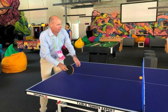 Tom Forbes plays table tennis at the Athlete's Village during a media visit on March 19, 2018.