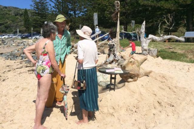 Rick Thomson-Jones  makes time to stop and chat with locals and visitors, at one of his beach sculptures.