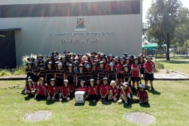 A group of primary school students in Blackall with the esky.