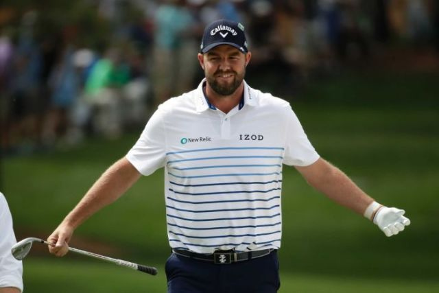 Australian golfer Marc Leishman spreads arms wide to celebrate his chip shot