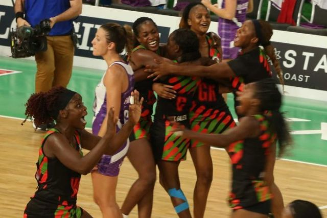 Malawi players celebrate on the netball court.