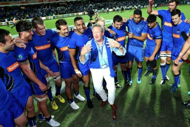 Mining magnate Andrew Forrest addresses Western Force players after their win over Fiji.