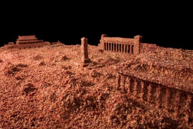 Guo Jian's artwork The Square. It's a model of Tiananmen Square covered in pork mince.