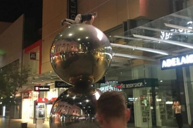 A daredevil on top of the Malls Balls in Rundle Mall.