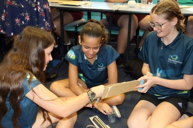 Three students work on a project at the Power of Engineering workshop in Darwin.