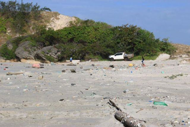 A photo of a beach covered in debris in East Arnhem Land.