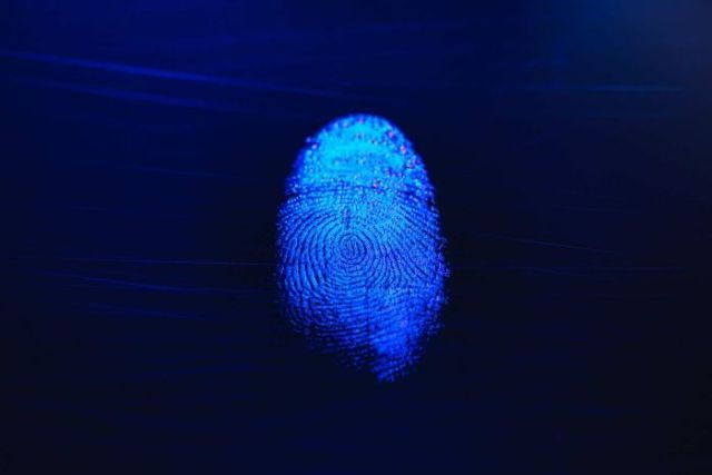 A shining fingerprint on a blue background