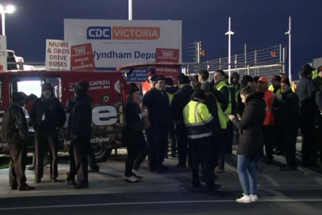 Striking bus drivers standing outside the CDC Victoria depot at Wyndham.