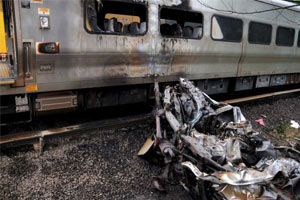 Two Injured as LIRR Train Hits Car on Tracks