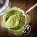 Moringa powder on a spoon, close up
