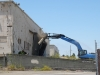 Crane begins demolition at Alameda Landing.