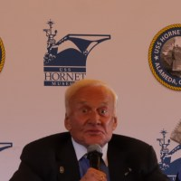 "Buzz Aldrin holding a copy of ""Congress at Your Fingertips"" (Action Alameda News)"