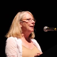 Donna Layburn, president, Park Street Business Association, speaks to the audience at Rhythmix. (Action Alameda News)