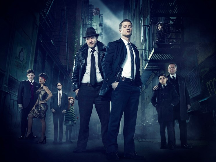GOTHAM: From left to right: Robin Lord Taylor as Oswald Cobblepot/The Penguin, Jada Pinkett Smith as Fish Mooney, Cory Michael Smith as Edward Nygma/future Riddler, Clare Foley as Ivy Pepper/future Poison Ivy, Donal Logue as Detective Harvey Bullock, Ben McKenzie as Detective James Gordon, Camren Bicondova (above, on fire escape) as Selina Kyle/future Catwoman, David Mazouz as Bruce Wayne and Sean Pertwee as Alfred Pennyworth star in Warner Bros. Television's Gotham, airing Mondays 8/7c on FOX this fall. (Photo Credit: © Warner Bros. Entertainment Inc. All Rights Reserved.)